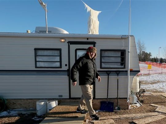 Roger Hanson exits a trailer he will spend much of