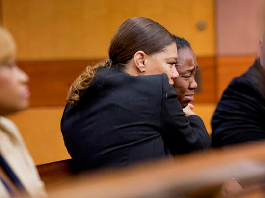 LaPrincia Brown, right, the half-sister of Bobbi Kristina Brown, is comforted by her step-mother Alicia Etheridge, after taking the witness stand in a wrongful death case against Bobbi Kristina's partner, Nick Gordon, in Atlanta, Thursday, Nov. 17, 2016. Bobbi Kristina Brown was found face-down and unresponsive in a bathtub in her suburban Atlanta townhome in January 2015.