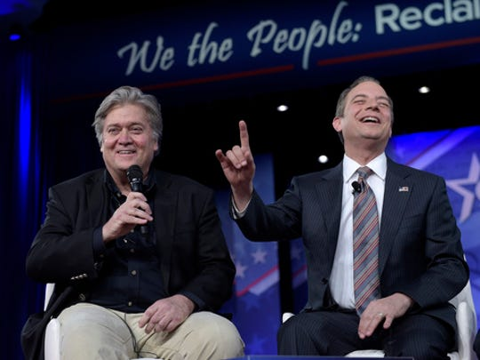 White House Chief of Staff Reince Priebus, right, accompanied by White House strategist Stephen Bannon, speaks at the Conservative Political Action Conference (CPAC) in Oxon Hill, Md., Thursday, Feb. 23, 2017.