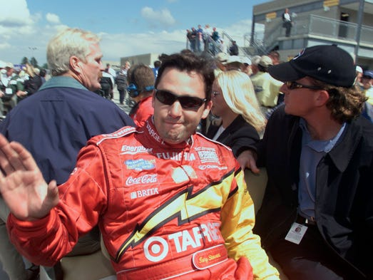 "5/27/01.  Tony Stewart waves to fans as he leaves the speedway after the race's conclusion.  Stewart rode straight to a waiting helicopter which took him to the Coca Cola 600 in Charlotte, NC.  Indianapolis 500.  He became the first driver to complete all 1,100 miles of both races in the same day. Stewart attempted the ""double duty"" in 1999 and 2002."