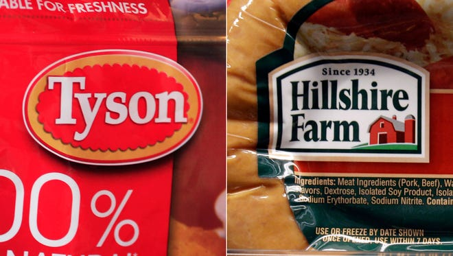 This combo made with file photos shows a package of frozen Tyson Chicken Nuggets, left, and a package of Hillshire Farm sausage, in Palo Alto, Calif. Two days after poultry producer Pilgrimís Pride made a $5.58 billion dollar bid for the maker of Ball Park hot dogs and Jimmy Dean sausages, Tyson Foods Co. on Thursday, May 29, 2014 sweetened the pot with a $6.2 billion offer. The deal sent Hillshire shares up 14 percent in premarket trading. (AP Photo/Paul Sakuma, File) ORG XMIT: NYBZ150