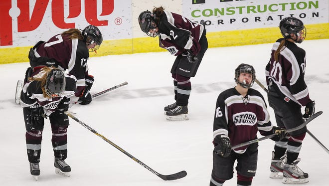 Members of the Central Wisconsin Storm react after a 1-0 loss to Hayward in a WIAA girls hockey state semifinal game last March