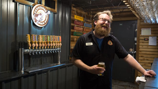 Tennessee Brew Works Taproom Manager Zach Gordon shares a laugh at the bar.
