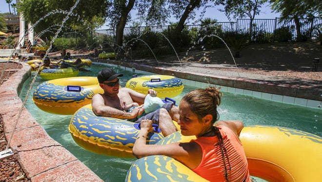 People relax on inmertibes at Oasis Water Park at Arizona Grand Resort in south Phoenix on June 19, 2016