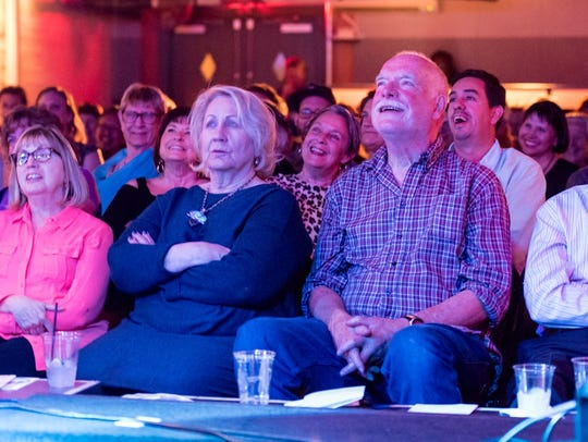 The audience listens to epidemiologist Mare Schumacher