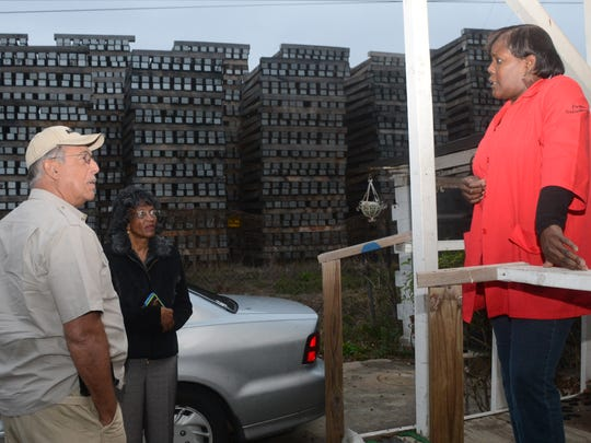 Retired Lt. Gen. Russel Honore (left) talks Tuesday with Bethel Street resident Debra White (far right) about living next to the Stella Jones Facility. White told Honore she has lived there for so long she doesn't notice the smell he mentioned.