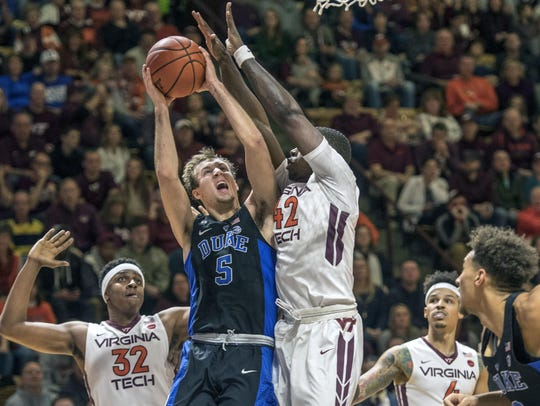 Duke guard Luke Kennard goes up for a basket against