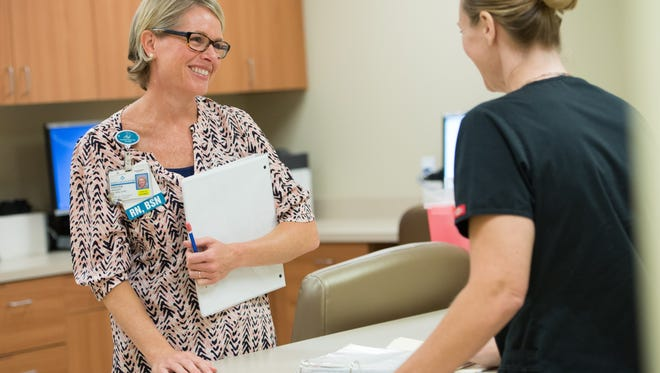 Martin Health System's Clinical Research Manager Kristen Sweeney, RN, BSN, CCRC, left, works with Martin Health System's Clinical Research Coordinator, Kensington Dangle, RN, at the Center for Clinical Research.