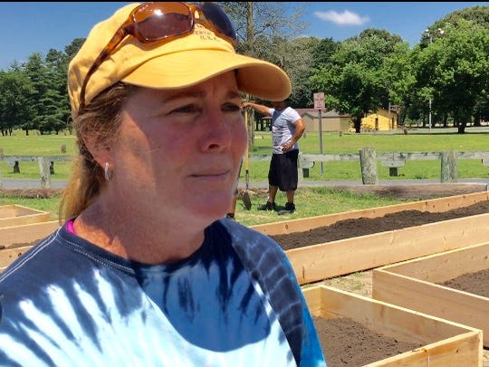 In this June 25, 2016 photo, Salisbury-area residents Liz Tilghman came out to the Salvation Army's Richard Hazel Youth Center to help volunteer as a frame maker for youth vegetable garden to be planted by participants in the center's summer camp now underway.  Tilghman intends to attend a June 29 meeting in Salisbury where community members hope to learn the fate of the center that faces closing in the wake of a financial shortfall.