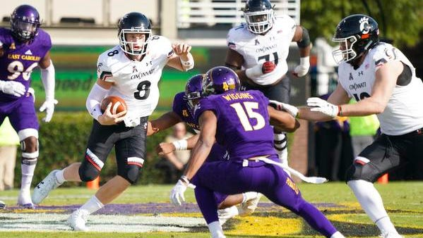 Cincinnati Bearcats quarterback Hayden Moore (8) runs with the ball during  the second quarter against the East Carolina Pirates at Dowdy-Ficklen Stadium.