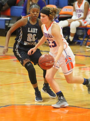 Central High School's Morgan Walker (23) had 13 points and three 3-pointers in the Lady Cats' 42-26 win against Killeen Shoemaker in the District 8-6A opener at Babe Didrikson Gym on Friday, Dec. 8, 2017.