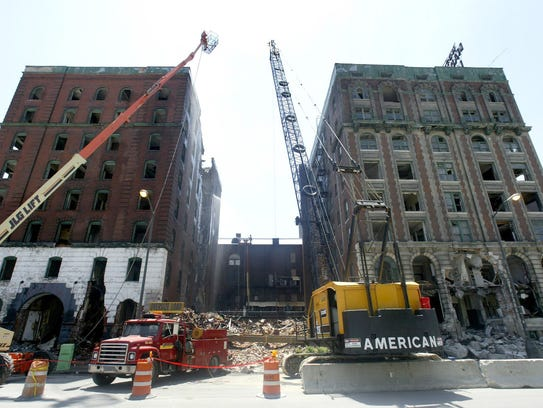 Demolition of the Madison-Lenox hotel is shown on Friday,
