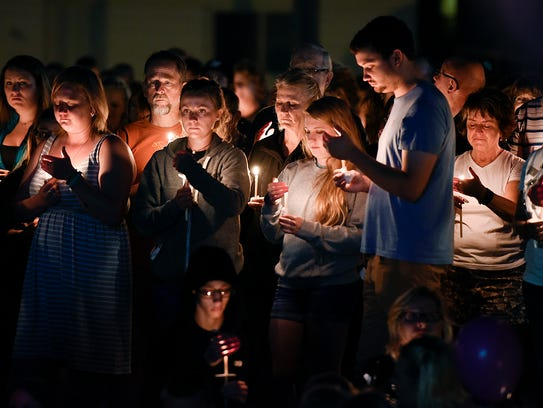 A candlelight vigil to honor the memory of Alayna Ertl,