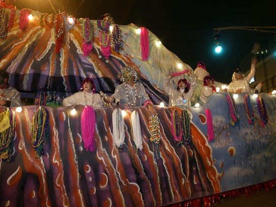 The Krewe of Rio Parade roll through Lafayette on Saturday