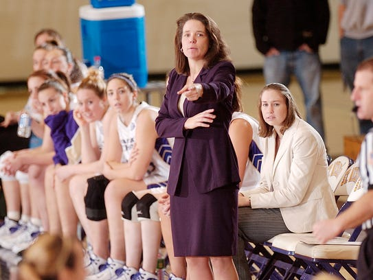 St. Michael's coach Jen Niebling directs her team against
