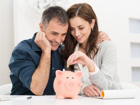 couple-saving-money-with-piggy-bank-getty_large.jpg