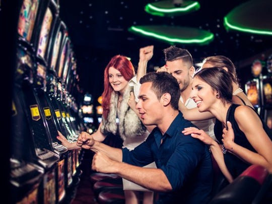 Millennials play  slot machines at an unidentified casino.