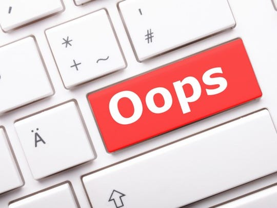 """Red key on keyboard, that says """"oops"""""""