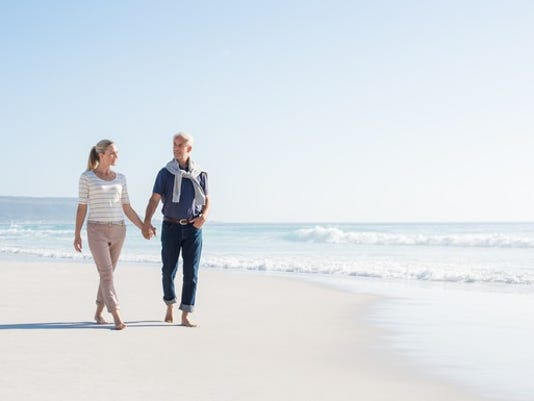 middle-aged-couple-walking-along-the-beach_gettyimages-530590290_large.jpg
