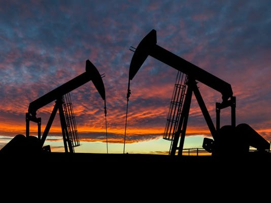 oil-pumps-in-canada-with-a-red-sunset_large.jpg