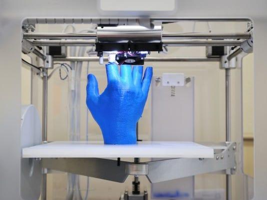 3d-printer-making-a-hand_large.jpg