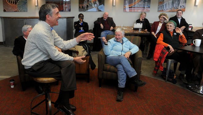 Rev. Spencer Turnipseed speaks to a group on Monday, January 18, 2016 in the lobby of the CNA Surety building.