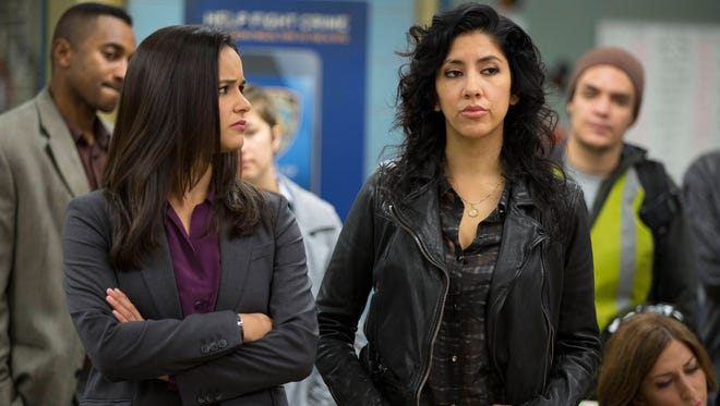 "Melissa Fumero (L) and Stephanie Beatriz appear in a scene from the comedy series, ""Brooklyn Nine-Nine."""