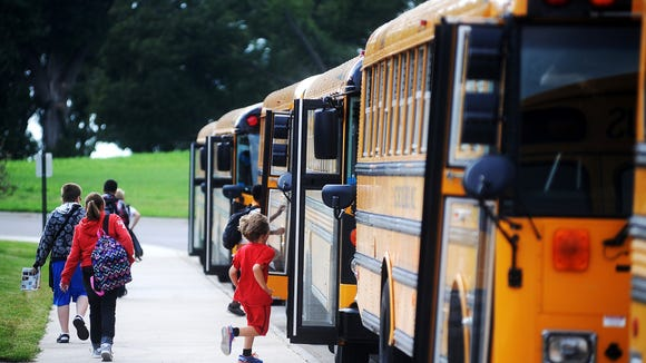 Sioux Falls students hitch a ride home at the end of a school day.