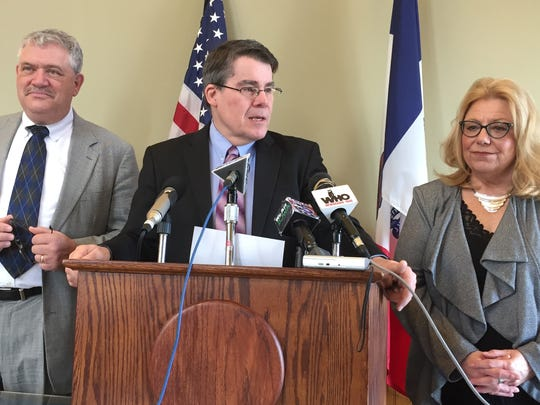 Senate Majority Leader Michael Gronstal, center, talks Thursday about a tax agreement reached with the Iowa House. At right is House Democratic Leader Mark Smith and on the left is Iowa Senate President Pam Jochum.