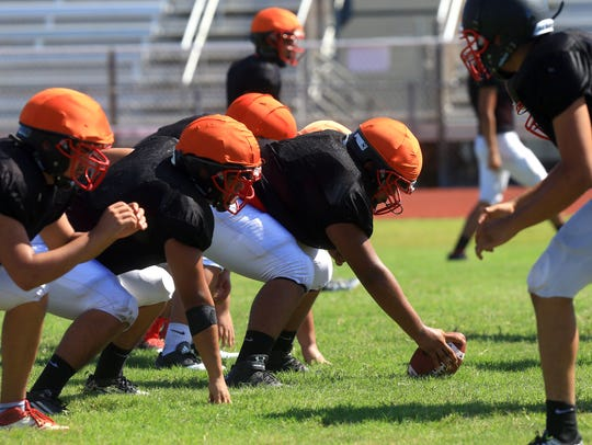 West Oso players run through drills during practice