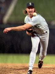 Randy Johnson pitches for the Seattle Mariners in a game in a 1995 playoff game against Texas.