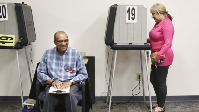 Montgomery County Election Official Ray Toliver waits as Montgomery County Election Commission chair Rita Wilson votes during a previous election.
