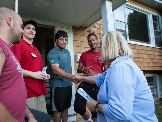 Property renters Ryan Robbins, Jonathan Smith, Seth McMullen, and David Leitzke chat with South Burlington City Council Chairwoman Pat Nowak about their experience with the community Friday on East Terrace.