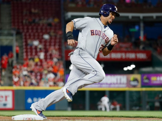 Houston Astros' Michael Brantley scores on a double by Yordan Alvarez off Cincinnati Reds starting pitcher Anthony DeSclafani during the sixth inning of a game Tuesday, June 18 in Cincinnati.