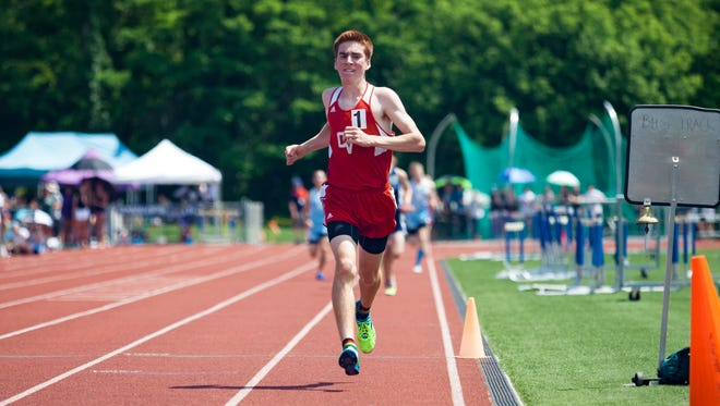 Champlain Valley's Tyler Marshall crosses the finish line in the 3,000 meters, his third victory during Saturday's Division I track and field state championship at Burlington High School.