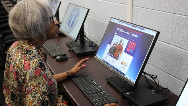 LaDonna Toney uses the computer at the Westland Friendship Center.