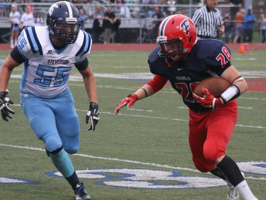 Nate Binkiewicz carries the ball upfield after catching