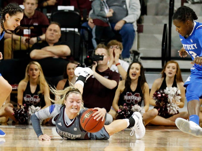 Mississippi State guard Blair Schaefer (1) reaches