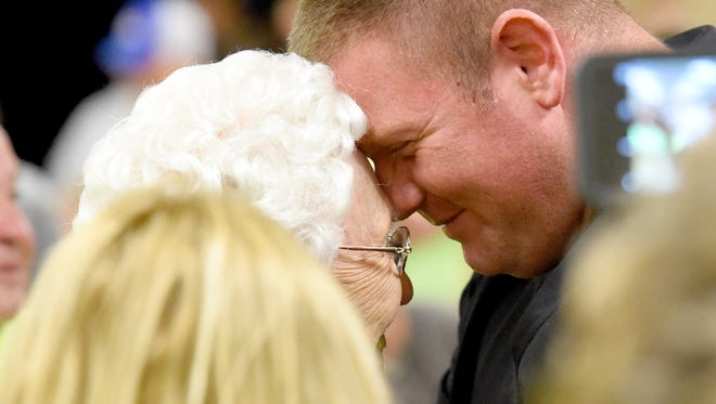 Sheriff candidate Donald Smith smiles and touches his head to that of his grandmother, Reba Hahn, after results so far announced have him in the lead while he is his watch party held at the Verona Fire Department on Tuesday, Nov. 3, 2015.