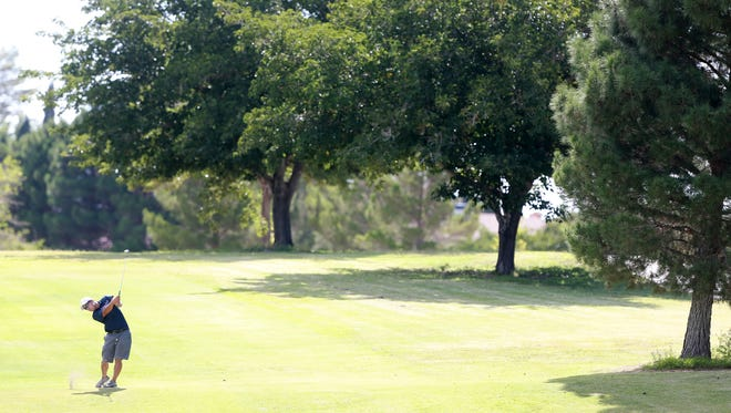 Richard Yai drives to the 14th green Friday at Vista Hills Country Club.