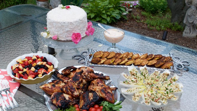 A cookout menu of fresh fruit salad, barbecue chicken, cauliflower caviar in endive leaves and corn fritters is topped off with a surprise birthday cake with coconut icing.