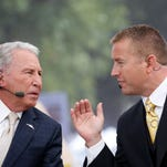 """ESPN """"College GameDay"""" analysts Lee Corso and Kirk Herbstreit, right, work Oct 11, 2014."""