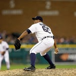 Detroit Tigers relief pitcher Angel Nesbitt throws during the ninth inning against the Oakland Athletics on June 3, 2015, in Detroit.