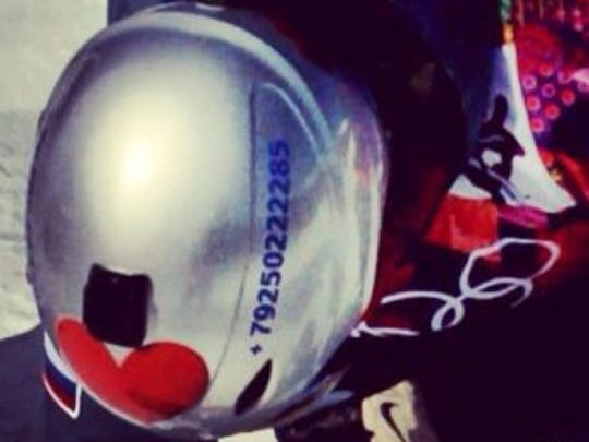A photo of the helmet with the phone number.