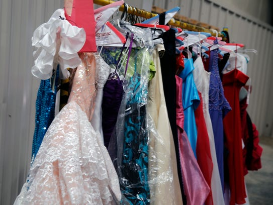 Donated dresses are pictured Friday at a warehouse