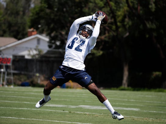 Los Angeles Chargers' Artavis Scott catches a pass at an NFL football training camp Sunday, July 30, 2017, in Costa Mesa, Calif. (AP Photo/Jae C. Hong)