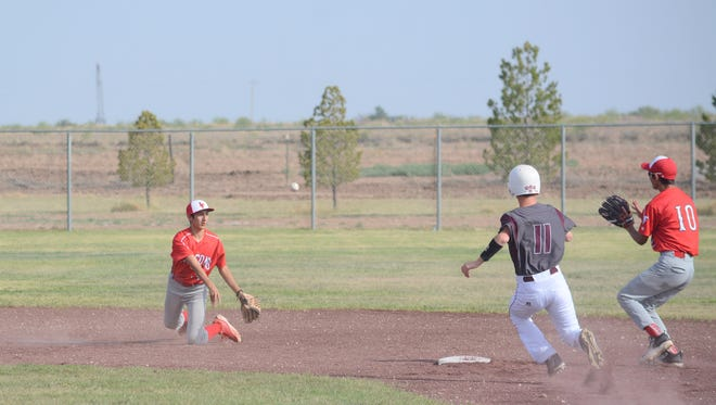 Loving's Avery Sierra throws to second base from his knees for a quick put out Tuesday against Tularosa.