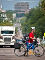 Cyclists, tractor-trailer trucks and passenger vehicles