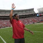 Avery Johnson waves to the crowd at Alabama's A-Day game Saturday at Bryant-Denny Stadium.
