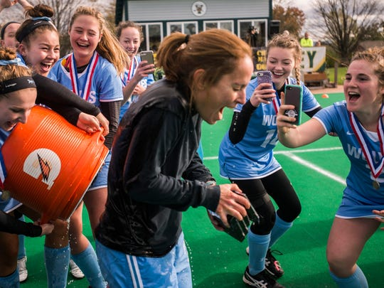 South Burlington High School Field Hockey Coach Anjie Soucy gets the water cooler after her team won the DI field hockey championship against CVU played at UVM on Saturday, Nov. 4, 2017. South Burlington won 3-0, capturing their third straight championship.